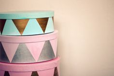 DIY: Make funky Storage Boxes with simple storage boxes that have been painted and metallic scrap paper cut-outs.