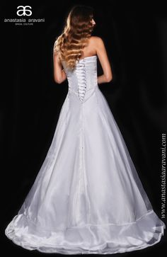 Romantic long white dress with corseted top and lace - design by Anastasia Aravani