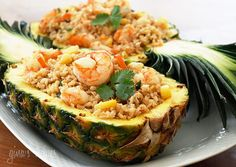 shrimp and rice stuffed pineapple -sounds good, maybe we will try this in the summer