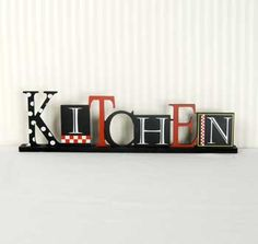 $23.99 This fun multi colored kitchen sign comes on a wooden base.  A wonderful gift for anyone who loves their kitchen