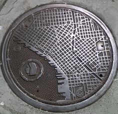 Manhole cover in Seattle bearing a map of the city