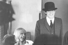 Pattie Boyd and Paul McCartney filming their dining car scene for A Hard Day's Night. Photo by Astrid Kirchherr.