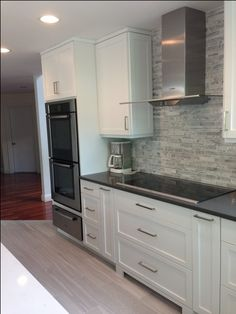 who loves their porcelain 'wood' floor tile? - Kitchens Forum - GardenWeb Shows transition from darker hardwood floors to lighter ones in kitchen - wood look tiles