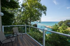 209 Park Avenue Unit #209, Charlevoix, MI 49720 listed by Trish Hartwick of Coldwell Banker Schmidt lakeview penthouseRare Penthouse level condominium w/ breathtaking views of Lake Michigan & the classic Pine River Channel. Relax on your deck & enjoy watching boats as they pass from Lake Michigan to Lake Charlevoix. End unit w/ large windows allow for lots of light & captures stunning views, open living, dining, & kitchen area, den w/ fireplace, and a main floor bedroom & full bath. This…