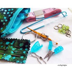 """I've created the """"Knitzy Kit"""", knitting tools, emergency knitting kit for on the go knitters (and crocheters). It starts with one of my handmade zipper pouches, in a cute, small size (3.5"""" x 5""""), in a pretty cotton batik fabric (this one is teal, turquoise & green). The pouch is lined with a contrasting cotton batik and interfaced to make it sturdy and durable, and has a little tab strap.    Anyone who knits will frequently throw a knitting project in your purse on the way out the door. It…"""