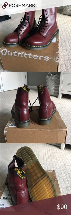 Cherry red Dr.Martens Slightly Worn Dr.Martens, about three or four times in total. Air cushioned sole. Have amazing traction for snow or any condition. Have some scratches on inner sides and fairly bent right under laces on left shoe due to walking/trying to break them in Dr. Martens Shoes Ankle Boots & Booties