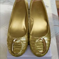 """Bijou Pump Shoes Bijou pumps Gold with ring detail. Low cut, closed round front. Padded insole, Sole Flexible, ribbed rubber. Heel is 1 3/4"""" high. Shoes are new never been worn. Please feel free to ask any questions. Thank you. Bijou Shoes Flats & Loafers"""