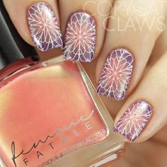 Stamping nail art using @emilydemolly stamping plate - This was done with EDM09 over a radial gradient of @femme_fatale_cosmetics Sunrise Funfair and @rescuebeauty Pause using the @uberchicbeauty XL Clear Stamper. #emilydemolly