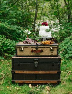 vintage trunk and suitcase used as a table for a wedding cake. would work well for a travel themed wedding as well.