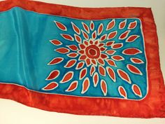 Hand painted silk scarf, approx. 14 x 72, Flat Crepe Silk, vibrant hues of turquoise & poppy red. Flat Crepe is lightweight and shiny. $56