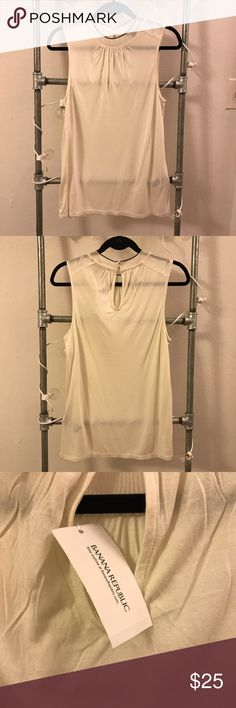Sleeveless tee with mock neck detail Great wear to work knit. Looks awesome tucked into high waisted pants or skirts! Banana Republic Tops Tank Tops