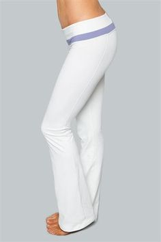 Libra Optic White Yoga Pants with Hyacinth Purple by Cozy Orange. Libras are about balance and these white yoga pants won't dissapoint. The bright optic white color is tempered with a hyacinth purple trim to tone it down. The thick Supplex fabric blend of these white yoga pants will keep you warm, provide compression and support no matter what kind of position you put yourself and these wide legt pants through. #yoga #yogapants