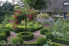 Formal herb garden with box-edged beds.
