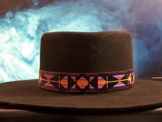 Native American Beaded Hat Band In The Southwestern Sunset Pattern with the colors of soft blues, reds and oranges with a black backdrop by LJ Greywolf This Native American Beaded Hat Band with a Sout