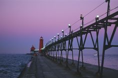 GRAND HAVEN, MICHIGAN Located on the Eastern shore of Lake Michigan and the mouth of the Grand River is this appropriately named town, which offers wine tasting, sand dune riding and an annual Coast Guard Festival at the end of every summer. Best Vacation Destinations, Best Vacations, Vacation Trips, Vacation Spots, Vacation Ideas, Vacation Places, Coast Guard Festival, Places To Travel, Places To See