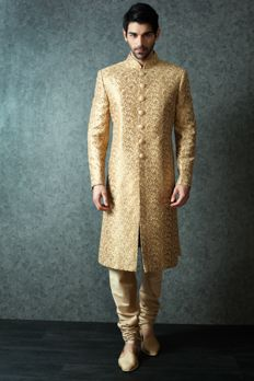 Sherwani embellished with heavy appliqué work highlighted with buttons from #Benzer #Benzerworld #Indowesternwearformen #Sherwani #jodhpuri