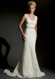 Gown features lace and keyhole back.