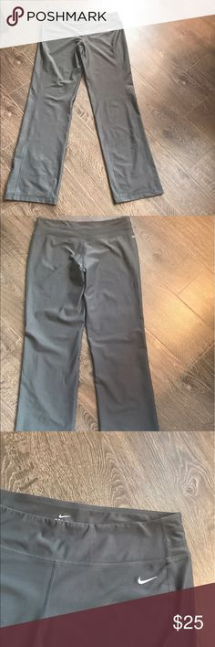 Nike Stretch Pants Size L grey women's Nike Stretch pants (full length). Worn 1-2 times. No tags, great condition. The last picture shows a tiny blemish the size of a pin head. This is where a tag was attached. No other flaws. Nike Pants Track Pants & Joggers