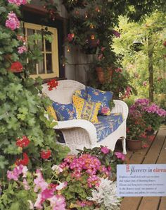 Cottage porch with white wicker loveseat surrounded by flowers (1) From: Lallee's Cottage, please visit