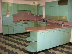 Pink and turquoise vintage kitchen.