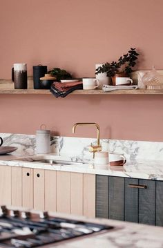 Pink backsplash in kitchen love the marble countertops and olive green and mauve pink cabinets #marblekitchencountertopsgreen