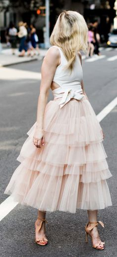 Swooning? We get it! This layered tulle skirt in a confectionary pink has us head over heels in love. Love Me More Layered Tulle Skirt  and A Fan of Bowknot Crop Top featured by Yael Steren Blog