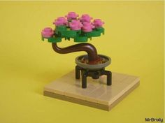 Found this adorable Bonsai tree. Can anyone tell me what the pink flower pieces are called? : lego