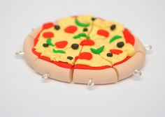 Handmade Polymer Clay Charm Pizza Set of 7 with Four Toppings. $9.50, via Etsy.