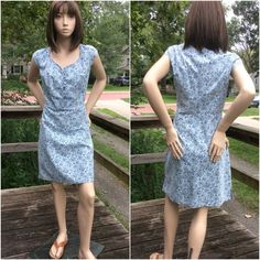 """Blue Chambray Dress NWOT Lovely cap sleeve dress with blue flower pattern. Button front, side zip. Shoulder to hem 35"""". Waist lying flat 16"""" Pit to pit 19 1/2"""". Hip 21"""" 100% cotton. NWOT The Territory Ahead Dresses"""