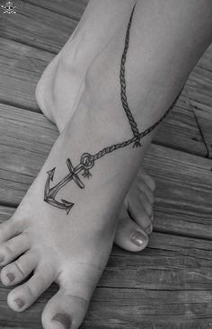 A more complicated but still very attractive anchor tattoo design for girls
