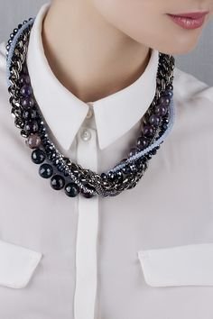 Twisted bib necklace with beaded segment and chains