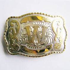 This monstrous chrome plated rodeo style belt buckle features a gold plated letter on the front.