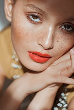Bright lips and freckles.