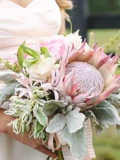 The always creative and cheerful Aquarius sign needs a wedding bouquet that truly showcases her bright personality. A unique bunch with proteas, wildflowers and dusty miller is exactly that.