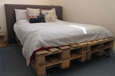 Furniture, The Incredible Wooden Pallet Bed With Wheels And England Flag Style Pillow Along With White Bed Cover As Well As The Clean Fur Rug And Creamy Brown Wall: Creating Wooden Pallet Bed