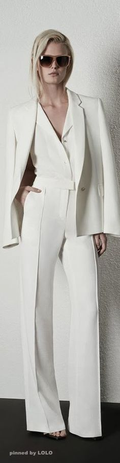 Another great style - all white outfit with the dramatic effect of the coat over the shoulders.