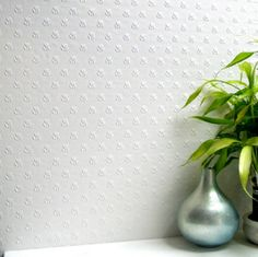 Salisbury / Floral (RD353) - Anaglypta Wallpapers - An embossed wallcovering for that more durable finish that can easily be painted to give the desired results. Delicate embossed flower motif. This wallcovering is white and is designed to be painted a colour of your choice. Please ask for a sample for true texture match.