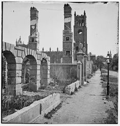 View of Broad Street, Charleston, South Carolina, 1865, looking east with the ruins of the Cathedral of St. John and St. Finbar visible. Photo courtesy of the Library of Congress.