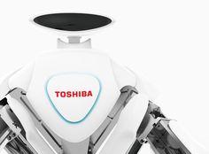 【油圧-電動ハイブリッド駆動型双腕ロボット】工場の組立ラインで人と協調して作業を行うことを目指して開発されたロボットです。動作状態を示す胸のブルーのライトは、優しく表示することで周りの作業員の安全確保だけでなく、安心感も与えます。