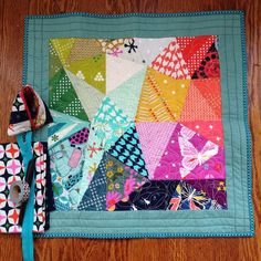 Finally--back from vacation and retrieved my packages. Happy to find this adorable #cottonandsteelminiquiltswap mini quilt from @thesistyuglers !! . I love it! The colors are perfect and the quilting so pretty! Thank you so much for this, and for the extras - fabric, pouch, gummy bears and more. You are so sweet! #tinselchen @modernstitchinmama @mushyhed