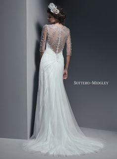 Flowing chiffon wedding dress, accented with illusion neckline and dazzling Swarovski crystals, Cara from Sottero and Midgley.