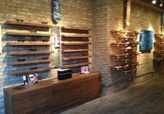 Chicago Eye Doctor, Chicago Optometrist, Chicago Eye Care - Contactsandspecs.com. Wood shelves over stone.