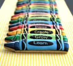 Crayola crayon cookies for teacher.  Loving the white shiny highlights.