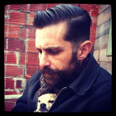 I like the juxtaposition of his expression and mountain-man beard with the small dog in his coat