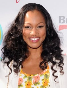 Garcelle Beauvais showed off her summer-ready glow in a bright floral frock paired with soft, free-flowing curls.