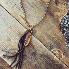 Sage Necklace - Bronze crystal feather necklace. Turquoise stone accent. Hand tooled leather feather. Lucky stamped coin. Dark brown leather accent tie. Long dark brown tassel. Hand crafted in Texas.