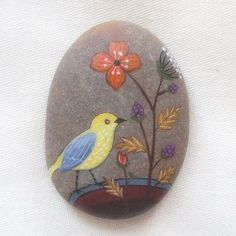 Bird and flowers painted on a stone