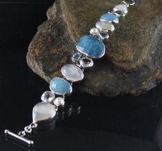 Unique handcrafted sterling silver bracelet featuring Aquamarine, Pearl and Rainbow Moonstone.