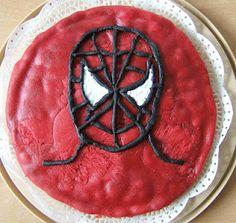 Spiderman Tarte for the 7th birthday of my son    Das war nur ein missglückter trockener Kuchen, der nicht aus der Form ging. Mit etwas Sahne und Marzipan neu verknetet und in Form gedrückt und dann mit Marzipan überzogen und Spidey draufgemalt :-)
