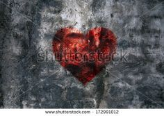 Red heart symbol on the old wall texture - stock photo